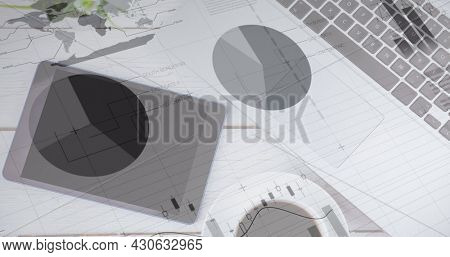 Image of statistics recording over tablet and computer keyboard. global finance and business concept digitally generated image.