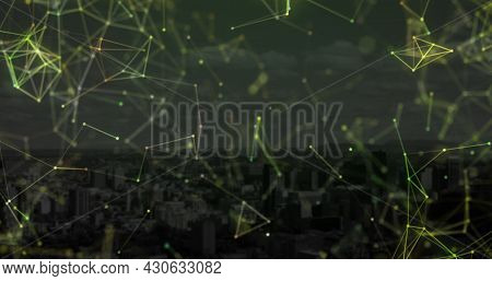 Image of floating digital network of connections over modern buildings. Global digital network technology finance concept digitally generated image.