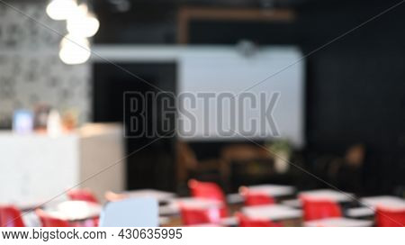 Blurred Abstract Background Of Conference Or Seminar Room.