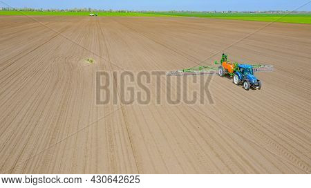 Above View, Overhead View On Tractor Until Spraying Big Endless Farmland Dragging Mounted Wide Agric