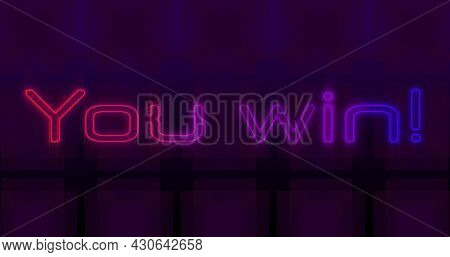 Image of image game screen with You win! text in flickering neon letters with multiple rows of abstract shapes moving in seamless loop. Retro image game concept digitally generated image.