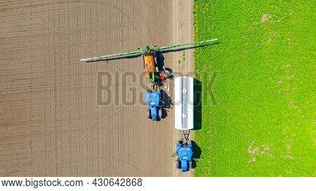 Above Top View, Overhead View On Two Farmers As They Preparing, Mixing Chemicals And Filling Sprayer