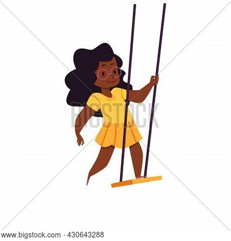Happy Little Girl Swinging Standing On Rope Swings In Park Or Playground.