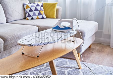 Iron For Ironing On Small Tabletop Ironing Board In Cozy And Living Room