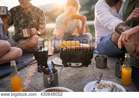 Midsection Of Happy Multigeneration Family On Summer Holiday Trip, Barbecue By Lake.