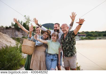 Happy Multigeneration Family On Hiking Trip On Summer Holiday, Taking Selfie.
