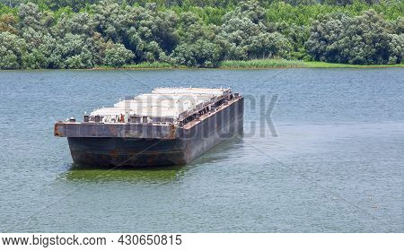 Barge Transports Cargo On The River. Selective Focus