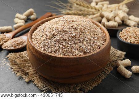 Wheat Bran In Bowl On Black Table