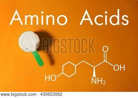 Measuring Scoop Of Amino Acids Powder On Orange Background, Top View