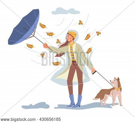 Female Personage Walking Dog Outdoors Under Rainy And Windy Weather In Autumn. Fall Seasonal Weather