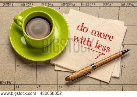 do more with less motivational note on napkin with a cup of coffee, productivity, smart work, business, education and personal development concept
