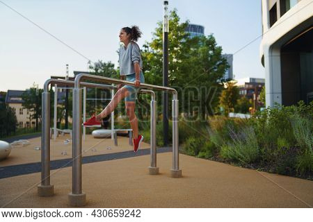Mid Adult Woman Doing Exercise On Parallel Bars Outdoors In City Workout Park, Healthy Lifestyle Con
