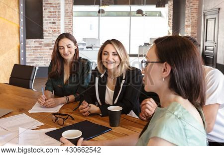 Group Of Young Successful People Business Professionals Having Meeting In Boardroom, Four Office Wor