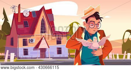 Good Man Holding White Dove On Hand, Caress And Communicate With Bird Front Of Suburban Cottage. Mal