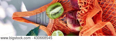 Banner Of Flat Lay Of Eco Friendly Mesh Shopping Bag With Fruits