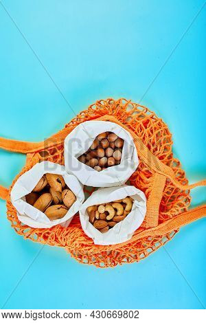Top View Of Various Sort Of Nuts On The Table In A Paper Bag In Shopping Grocery