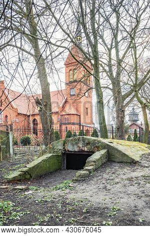 Entrance To The Basement Or Old Bunker In Front Of The Gothic Cathedral
