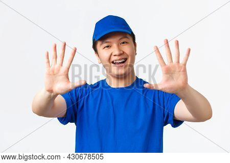 Online Shopping, Fast Shipping, Employees And Home Delivery Concept. Confident Smiling Asian Male Co
