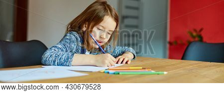 Banner Of School Girl Drawing And Writing A Picture With Crayons, Using Colored Pencils