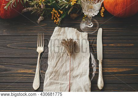 Thanksgiving Dinner Rustic Table Setting. Modern Plate With Vintage Cutlery, Linen Napkin, Herb On W