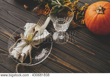 Modern Plate With Vintage Cutlery, Linen Napkin, Herb And Glass On Wooden Table With Pumpkins And Au