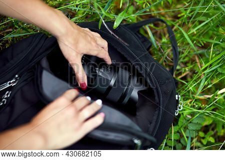 Photographer Woman Pack Or Takes Out Her Camera Backpack