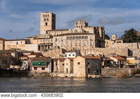 Zamora, Spain - February 02, 2020: Zamora Romanesque Cathedral And Bell Towers Since Duero River. Sp