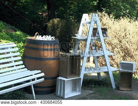 Original Wedding Bar In The Shadowy Garden.  Ladder, Barrel, Benchand Wooden Boxes As Romantic Rural