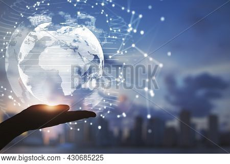 Close Up Of Hands Holding Abstract Glowing Polygonal Globe On Blurry City Background. Network, Commu