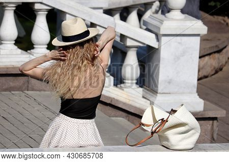 Woman In Hat With Blonde Curly Hair Fix Her Hairstyle Standing On Stone Staircase. Happy Lady, Hot W