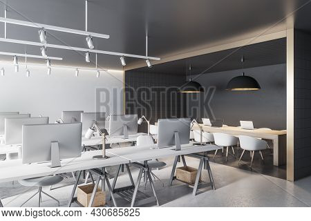 Contemporary Coworking Office Interior With Black Tile Partition, Equipment, Furniture And Daylight.