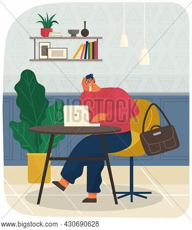 Office Manager Sitting At Table And Working With Laptop. Young Guy In Glasses Works At Computer, Bag