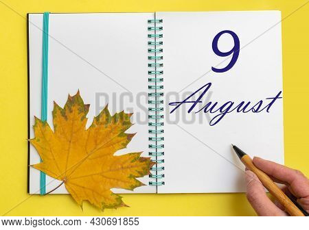 9th Day Of August. Hand Writing The Date 9 August In An Open Notebook With A Beautiful Natural Maple