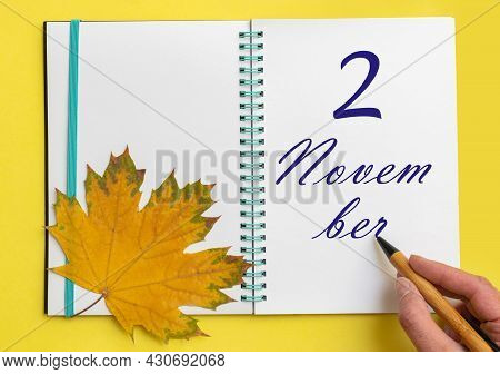 2nd Day Of November. Hand Writing The Date 2 November In An Open Notebook With A Beautiful Natural M
