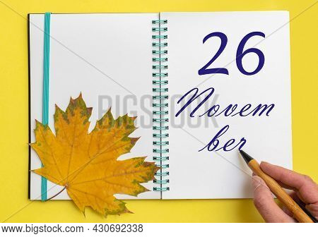 26th Day Of November. Hand Writing The Date 26 November In An Open Notebook With A Beautiful Natural