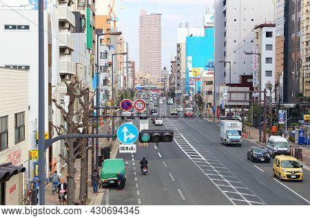 Osaka, Japan - November 22, 2016: People Drive In Traffic In Osaka, Japan. Osaka Belongs To 2nd Larg