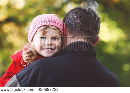 Happy Young Father Having Fun Cute Toddler Daughter, Family Portrait Together. Middle-aged Man With