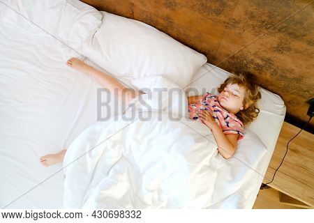 Cute Little Toddler Girl Sleeping In Bed. Adorable Baby Child Dreaming, Healthy Sleep Of Children By