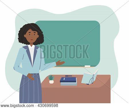 African American Female School Or University Teacher Or Professor Standing Next To Classroom Chalkbo