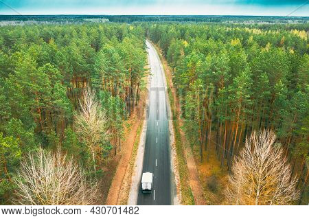 Aerial View Of Highway Road Through Spring Forest Landscape. Top View Of Truck Tractor Unit Prime Mo
