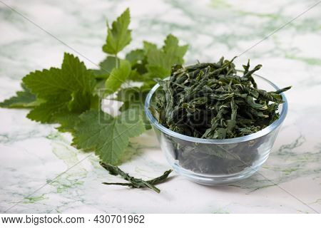 Fermentation Of Currant Leaves By Twisting Method For Herbal Tea At Home. Bowl With Fermented Twiste