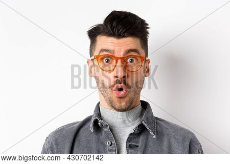 Wow Look There. Excited Handsome Man In Stylish Glasses Stare Impressed At Camera, Checking Out Eyew