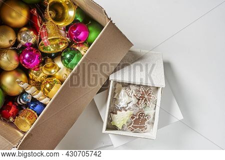 Merry Christmas Background With Xmas Decors And Cookies. Tasty Christmas Cookies And X-mas Tree Baub
