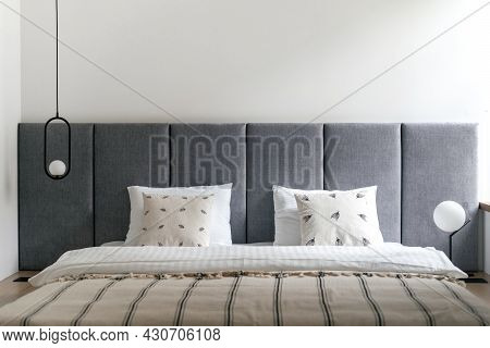 Bedroom Interior, Bed At Modern Apartment Design. Furniture Bedhead With Pillows In Home. Closeup At