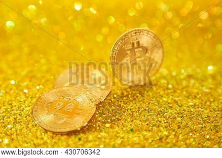 Three Bitcoin Coins. Cryptocurrency Bitcoin Is The Coin Of The Future. Golden Bitcoin. Golden Shiny