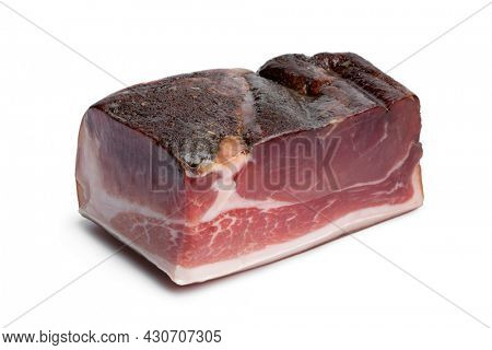 Piece of German speck close up isolated on white background