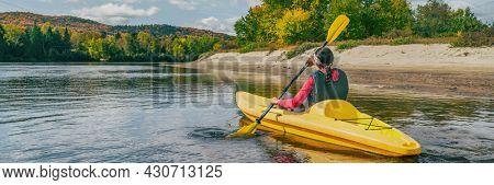 Kayak on river in Laurentians, Quebec .Canada travel destination banner. Woman kayaker kayaking down the river in Mont-Tremblant.