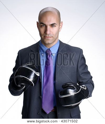 Bald head businessman using boxing gloves. poster