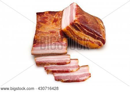 Whole Smoked pork bacon with slices on a white background. Food product.