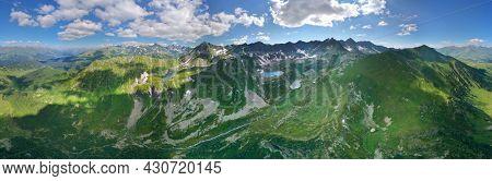The beautiful summer landscape of Caucasus mountains panorama. Dukka lakes near Arkhyz village in Russia. Daylight mountain landscape.